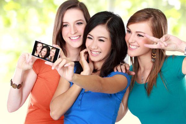 teens taking a selfie