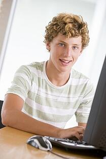 teen using his computer for twitter